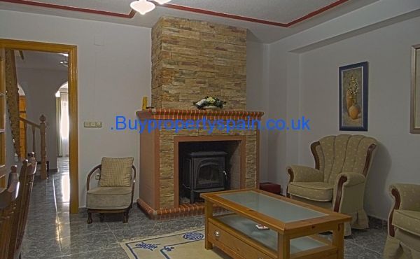 Downstairs living room with wood burner